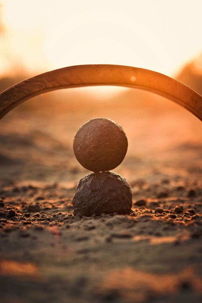 arch over a stone ball balanced on a second one (Pixabay)